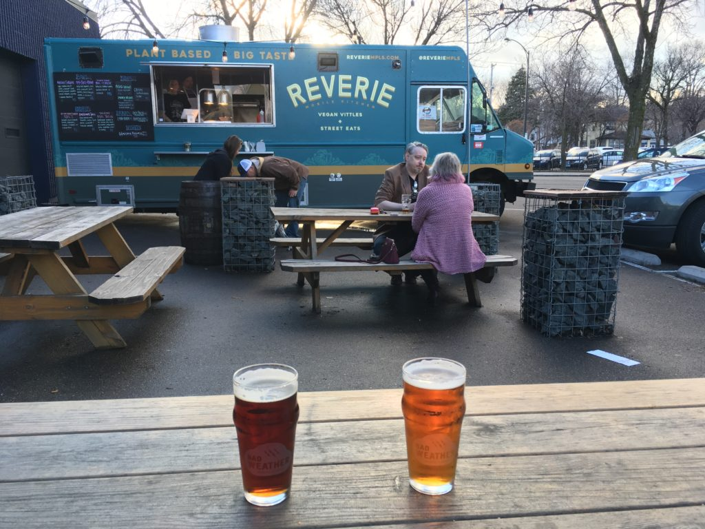 Two beers and a food truck
